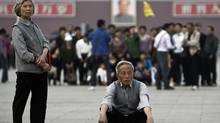 Elderly Chinese visit Tiananmen Square in Beijing on April 28, 2011. China's population is aging rapidly and half the people now live in cities, the government said Thursday. (Andy Wong/AP)