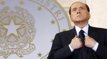 Then Italian Prime Minister Silvio Berlusconi looks on as he leads a news conference with French President Nicolas Sarkozy at Villa Madama in Rome in this April 26, 2011 file photo. An Italian court on October 26, 2012 sentenced former prime minister Berlusconi to four years in jail for tax fraud in connection with the purchase of broadcasting rights by his Mediaset television company. (ALESSANDRO BIANCHI/REUTERS)