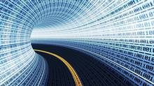 A road running through a tunnel of data. (istockphoto.com)