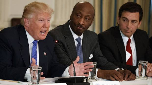 In this Thursday, Feb. 23, 2017, file photo, President Donald Trump, left, speaks during a meeting with manufacturing executives at the White House in Washington, including Merck CEO Kenneth Frazier, center, and Ford CEO Mark Fields.