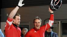 Canada's Pierre Lueders wave after finishing their final heat in the two-man bobsleigh event at the Vancouver 2010 Winter Olympics in Whistler, British Columbia, February 21, 2010. (JIM YOUNG/REUTERS)