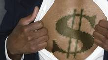 Businessman showing a dollar sign on his chest. (Comstock/Getty Images/Comstock Images)
