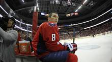 In this photo taken with a fisheye lens, Washington Capitals right wing Alex Ovechkin (8), of Russia, looks on during a break in the action in the first period of an NHL game against the Boston Bruins, Saturday, March 29, 2014, in Washington. (Nick Wass/AP)