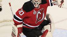 New Jersey Devils goalie Martin Brodeur makes a save on the Los Angeles Kings during the second period in Game 5 of the NHL Stanley Cup hockey final in Newark, New Jersey, June 9, 2012. (Shannon Stapleton/REUTERS)