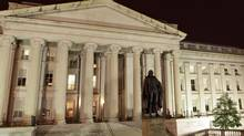 This March 27, 2009 photo shows the Treasury Building in Washington. (J. SCOTT APPLEWHITE/THE ASSOCIATED PRESS)