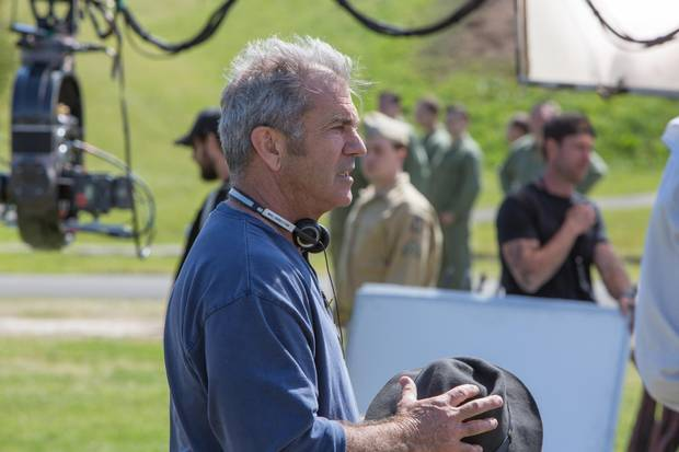 Director Mel Gibson on the set of Hacksaw Ridge.