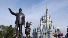 A statue of Walt Disney and Mickey Mouse stands in front of the Cinderella's castle at Walt Disney World's Magic Kingdom in Lake Buena Vista, Florida. (Matt Stroshane)
