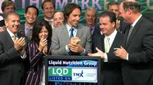 Liquid Nutrition co-founders Greg and Chantal Chamandy, two-time NBA MVP Steve Nash; Liquid Nutrition president and CEO, Glenn Young; and TMX Group CEO, Tom Kloet, celebrate the company's listing by opening trading on the Toronto Stock Exchange, Tuesday, Sept.13, 2011. (SALVATORE SACCO/MARKETWIRE)