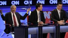 Republican presidential candidate Rep. Ron Paul, R-Texas, left, makes a point as former Pennsylvania Sen. Rick Santorum, center, and former Massachusetts Gov. Mitt Romney listen during a Republican presidential debate Wednesday, Feb. 22, 2012, in Mesa, Ariz. (Jae C. Hong/AP/Jae C. Hong/AP)