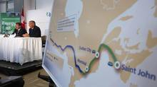 TransCanada President and CEO Russ Girling (second from left) announces the new Energy East Pipeline during a news conference in Calgary, Alberta, August 1, 2013. (TODD KOROL/REUTERS)