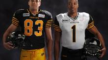 Quarterback Henry Burris (right) and receiver Andy Fantuz model the team's new jerseys in Hamilton, April 24, 2012. (THE CANADIAN PRESS)