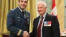 Captain Aaron Noble, left, of Burnaby, British Columbia, shakes hands with Governor General David Johnston after he was presented with the Military Meritorious Service Cross in Ottawa, Tuesday, Feburary 18, 2014. (Fred Chartrand/THE CANADIAN PRESS)