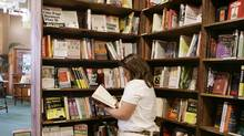 A customer browses through books at the Tattered Cover bookstore in downtown Denver on Thursday, May 24, 2007. (Ed Andrieski/Associated Press/Ed Andrieski/Associated Press)