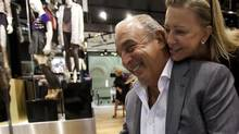 Sir Philip Green of TopShop confers with Hudson's Bay Co. CEO and president Bonnie Brooks at the TopShop location inside Yorkdale Mall in Toronto Oct. 4, 2011. (Tim Fraser for The Globe and Mail)