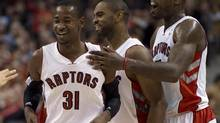 Toronto Raptors guard Terrence Ross (31) is congratulated by teammates Amir Johnson (right) and Alan Anderson (centre) after making a buzzer-beating three-pointer against the Portland Trail Blazers at the end of the first half during NBA action in Toronto on Wednesday January 2, 2013. (Frank Gunn/THE CANADIAN PRESS)