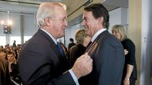 Quebecor Inc. president and CEO Pierre Karl Peladeau, right, greets former prime minister Brian Mulroney at the company's annual general meeting in Montreal Wednesday, May 9, 2012. (Graham Hughes/THE CANADIAN PRESS/Graham Hughes/THE CANADIAN PRESS)