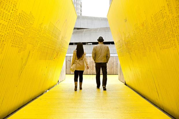 Each yellow, wooden board on the Luchtsingel pedestrian bridge has the name of someone who contributed to the crowd funding campaign.