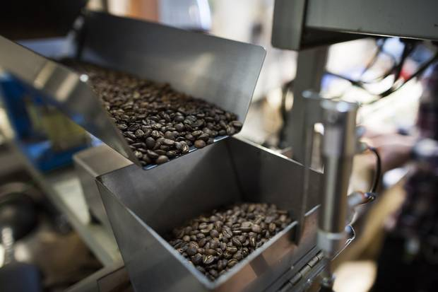 Coffee is packaged at the JJ Bean Coffee Roasters warehouse in Vancouver, Dec. 8, 2017.