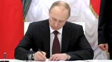 Russian President Vladimir Putin signs into law a treaty annexing Ukraine's Crimea peninsula. Rough cut (no reporter narration) (Reuters)