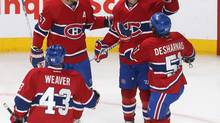 Montreal Canadiens left wing Thomas Vanek (20) celebrates his goal against Colorado Avalanche with teammates defenceman Mike Weaver (43) and centre David Desharnais (51) and left wing Max Pacioretty (67) during the second period at Bell Centre. (Jean-Yves Ahern/USA Today Sports)