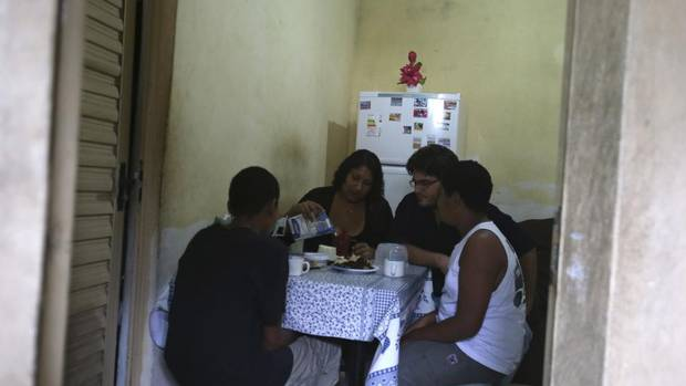 Rosimeire de Souza and her boyfriend André Tamandaré (second right) have breakfast with Rosimeire's sons Felipe (L) and Mateus (R) at their home in Sao Goncalo July 1, 2013. Over the past decade, Mr. Tamandaré, a 33-year-old high-school dropout, has moved into his own house, got a steady job and earned enough income with his long-time girlfriend, Ms. de Souza, to lead their two kids into Brazil's fast-rising middle class. (PILAR OLIVARES/REUTERS)