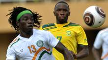 South Africa's Majoro Llehlohonolo (2-L) vies for the ball with Chiloto Mohamed (L) of during an elimination round for the Cup of African Nations (CAN) 2012, in Naimey on September 4, 2011. Niger won 2-1. Getty Images/ SIA KAMBOU (SIA KAMBOU/Getty Images)