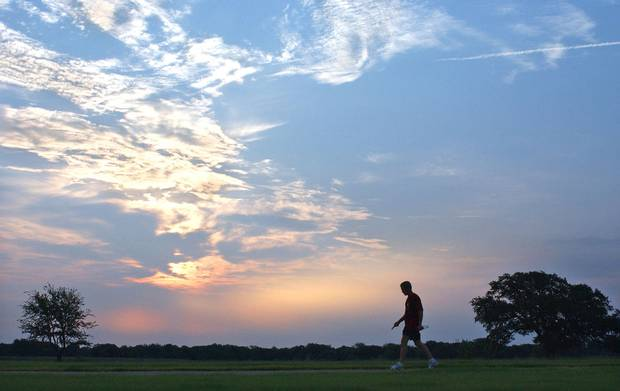 Aug. 9, 2002: U.S. president George W. Bush is silhouetted against an early morning sky after a run at his ranch in Crawford, Texas on August 9, 2002.