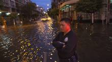 A Thai policeman stands guard helping to direct traffic through flooded Bangkok streets Wednesday, Oct. 26, 2011. Hundreds of factories are closed as the flood waters began to reach Bangkok. Paula Bronstein/Getty Images (Paula Bronstein/Getty Images)