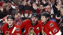Fans celebrate a goal against the Montreal Canadiens with Ottawa Senators' Mark Borowiecki (L), Chris Phillips (C) and Zack Smith during the second period of their NHL game in Ottawa January 30, 2013. (BLAIR GABLE/REUTERS)