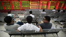 Investors watch an electronic board at a stock exchange hall on August 19, 2011, in Huaibei, Anhui Province of China. (ChinaFotoPress/ChinaFotoPress/Getty Images)