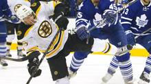 Toronto Maple Leafs Mark Fraser (R) trips up Boston Bruins David Krejci at centre ice in the first period of their NHL hockey game in Toronto March 23, 2013. (FRED THORNHILL/REUTERS)