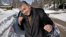 Boxing legend George Chuvalo with his Infiniti EX35. (Moe Doiron/Moe Doiron/The Globe and Mail)