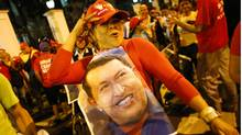 Supporters of Venezuelan president Hugo Chavez gather outside Miraflores Palace to wait for the results of Presidential elections in Caracas October 7, 2012. (Jorge Silva/REUTERS)