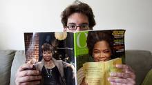 Hal Niedzviecky, author of The Peep Diaries, holds the recent issue of O, The Oprah Magazine, which lists his book as one of 25 Books You Can't Put Down. (Della Rollins for the Globe and Mail) (Della Rollins)
