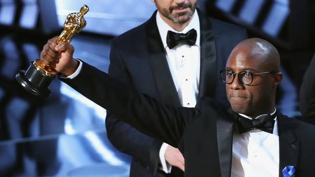 Director Barry Jenkins holds the Oscar after his film Moonlight wins the best-picture award on. Feb 26, 2017.