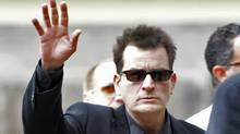 "In a Aug. 2, 2010 file photo, Charlie Sheen waves as he arrives at the Pitkin County Courthouse in Aspen, Colo., for a hearing in his domestic abuse case. Sheen says Wednesday, March 2, 2011 that after his two young sons were removed from his house overnight, he's ""very calm and focused"" but ready to fight to get them back. (Ed Andrieski/AP)"