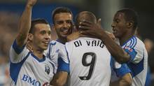 Montreal Impact's Felipe Martins, left to right, Dennis Iapichino, Marco Di Vaio and Patrice Bernier celebrate after Di Vaio scored against the San Jose Earthquakes during first half MLS action in Montreal, Saturday, August 18, 2012. (Graham Hughes/THE CANADIAN PRESS)