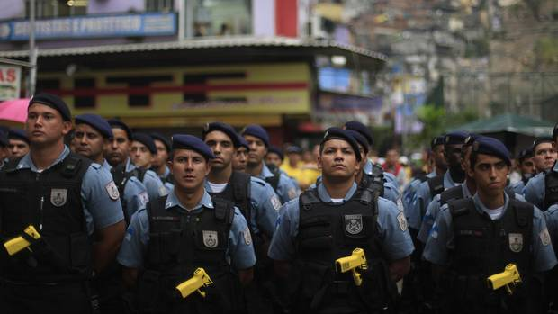 Policemen stand in line during the inauguration of the Peacekeeping Unit Program (UPP) in Rio de Janeiro's Rocinha slum on Sept. 20, 2012.