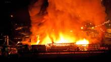 A large fire burns at the Lakeland Mills sawmill in Prince George, B.C., on Tuesday April 24, 2012. Provincial officials have not yet decided whether there will be a criminal prosecution in the case. (ANDREW JOHNSON/THE CANADIAN PRESS)