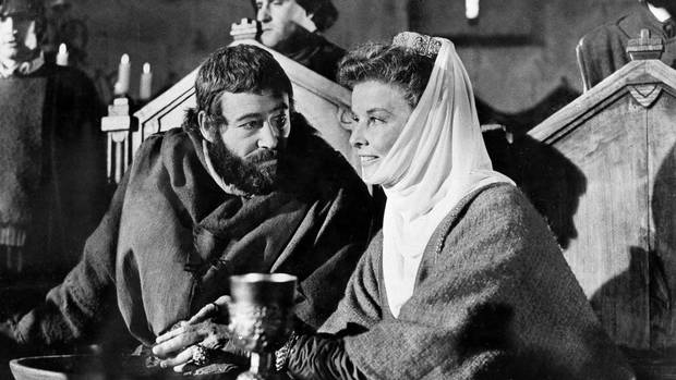 This 1968 file image shows American actress Katharine Hepburn, right, as she plays the part of Queen Eleanor of Aquitaine with co-star Peter O'Toole as King Henry II of England, in the film The Lion In Winter. (Anonymous/AP)