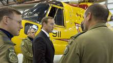 Defence Minister Peter MacKay speaks with search-and-rescue personnel in front of a Cormorant helicopter in Halifax on Sept. 12, 2007. (Andrew Vaughan/Andrew Vaughan/The Canadian Press)