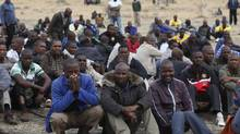 Mine workers gather while on strike near the scene of a shooting at Marikana, in the north western province August 27, 2012. (MIKE HUTCHINGS/REUTERS)