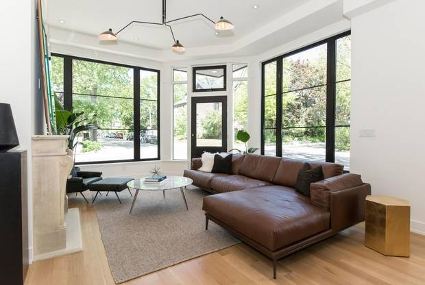 The store windows bring a lot of light into the living room.
