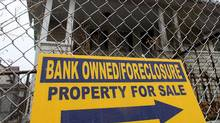 A sign is displayed in front of a foreclosed home on March 12, 2010 in Bridgeport, Conn. (Spencer Platt/Getty Images)