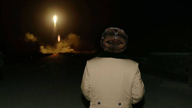 An undated picture released from North Korea's official news agency shows North Korean leader Kim Jong-un attending a mobile drill for ballistic rocket launches at an undisclosed location in 2016.