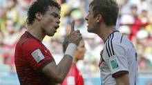Portugal's Pepe, left, argues with Germany's Thomas Mueller after they clashed during the group G World Cup soccer match between Germany and Portugal at the Arena Fonte Nova in Salvador, Brazil, Monday, June 16, 2014. (Matthias Schrader/AP)