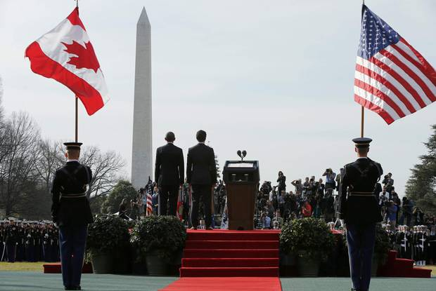 Mr. Obama and Mr. Trudeau stand together during Thursday's arrival ceremony.