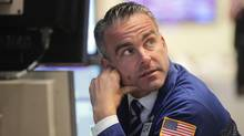 A trader works on the floor of the New York Stock Exchange on October 7, 2011 in New York City. (Spencer Platt/Spencer Platt/Getty Images)