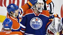 Edmonton Oilers Ryan Smyth (94), Philip Larsen (36) and goalie Ben Scrivens (30) celebrate the win over the San Jose Sharks during NHL hockey action in Edmonton, Alta., on Wednesday, January 29, 2014. (JASON FRANSON/THE CANADIAN PRESS)