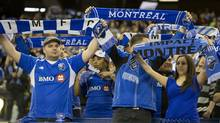 Montreal Impact fans welcome their team onto the field Montreal before Major League Soccer action against the Toronto FC at the Olympic Stadium in Montreal Quebec Saturday March 16, 2013. (Peter McCabe/The Canadian Press)